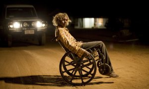 Samson driving around in a wheelchair. Source: The Guardian