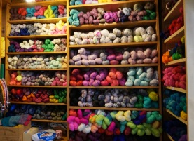 Shelves full of colorful yarns (©Julie Beaurain)